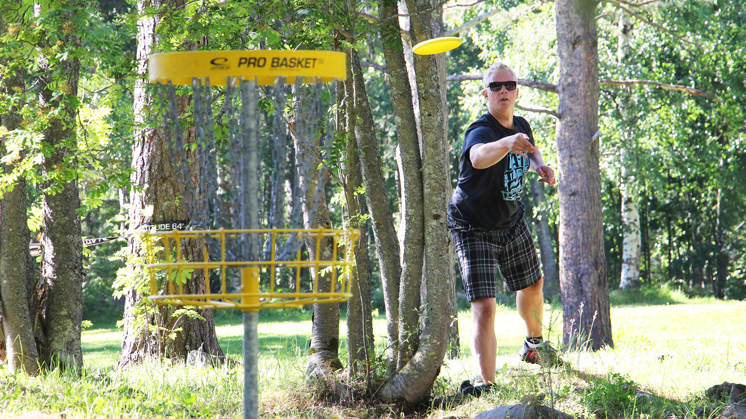 Disc Golf, also called Frisbee Golf, is all about getting the disc in the basket in the least amount of throws.